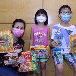 派發防疫用品及食品、提供網上學習及經濟支援 助基層家庭在疫情下渡過難關